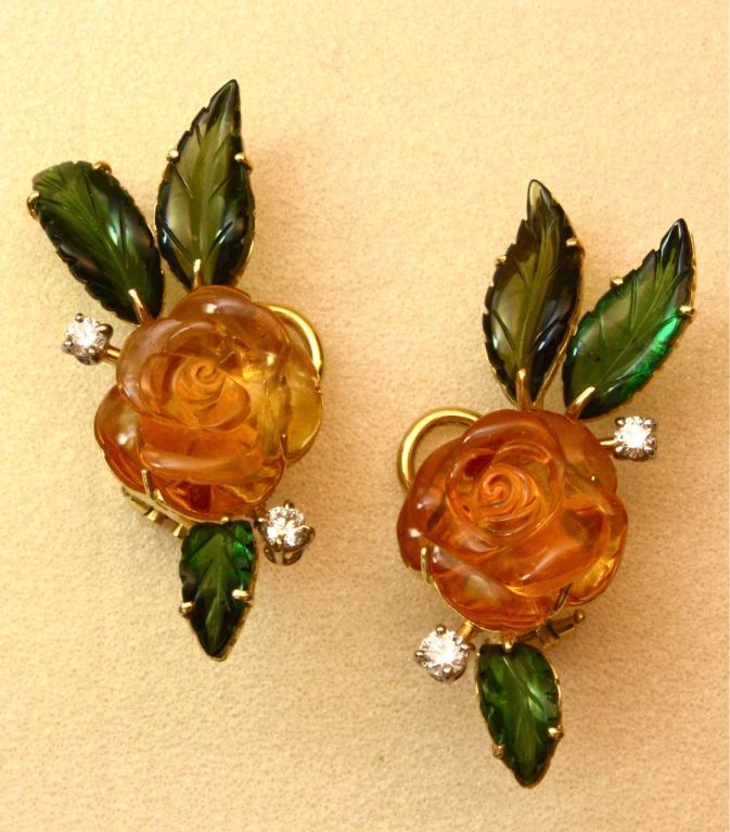 These richly colored flower earclips are completely handmade and absolutely one of a kind.  The cognac colored citrine flowers and the forest green tourmaline leaves were expertly done in Idar-Oberstein, Germany and the delicate 18kt gold mounting
