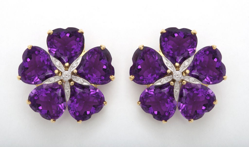 The finest deep, rich purple amethysts never fail to be noticed- especially in these dramatic flower earclips.  Highlighting the center are round diamonds set into white gold, which cast just the right amount of light.  These earclips are