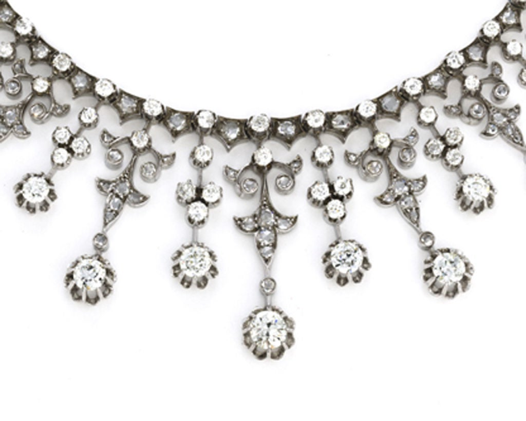 Victorian 18 karat gold, silver, platinum overlay and diamond French hallmarked fringe necklace. The rear portion of the necklace is set with 18 old mine-cut diamonds interspersed with 55 rose-cut diamonds connecting on either side to the front