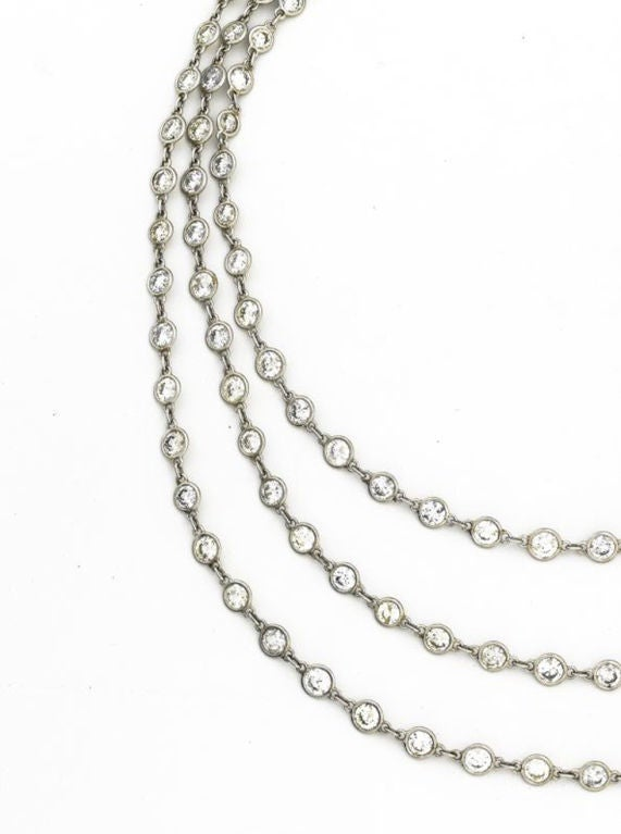 Platinum and diamond longchain set with 154 round brilliant-cut diamonds weighing approximately 35 carats, color: H-I-J, clarity: SI1 - I1. Chain measures 49 1/2 inches long and is completed by a diamond-set spring ring.
