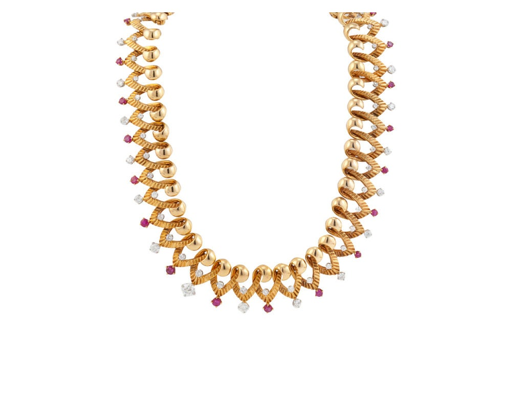 The necklace is composed of a series of V motifs with grooved surfaces set with 66 round single-cut, transitional-cut, old European-cut and brilliant-cut diamonds, total weight is approximately 3.56 carats, color: F-G, clarity: VS-SI, and 23 round