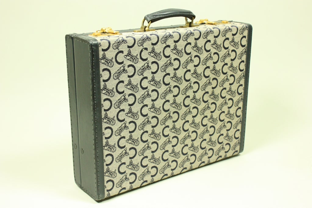 Vintage case from Celine dates to the 1970's and is made of monogrammed canvas and navy leather.  Gold-toned hardware.  Navy leather interior.