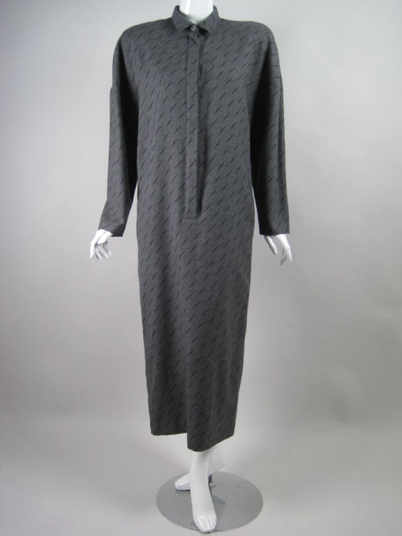 Krizia maxi-length dress from the 1980's.  Gray wool with black slash pattern.  Turn down collar with lapped center front button placket.  Side seam hip pockets.  Inverted v silhouette.  Shoulder pads.  Unlined.  Labeled size