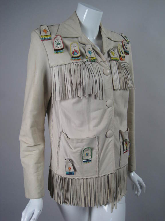 "Rare 1940's jacket from ""Danz"" in Tuscon, Arizona epitomizes Western Wear of that era.  It is made out of extremely soft deerskin with long fringe across the front and back yoke, down the sleeves, and around the hem.  Brightly-colored beaded"