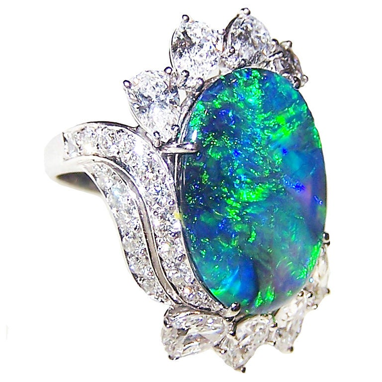 Id J 41915 on oscar heyman emerald ring