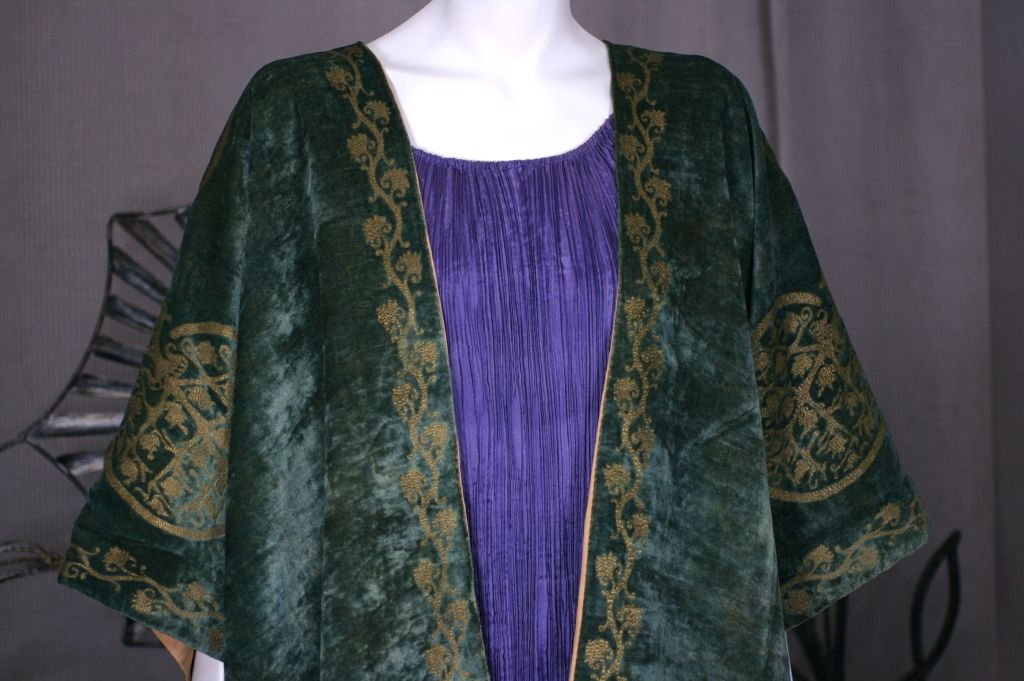 Fortuny translated the caftan as a loose fitting outer garment,usually made out of silk velvet crepe or gauze the fitted back and open front allowed for elaborate stenciled decoration and  venetian bead trim.<br /> <br /> The hand stenciling is