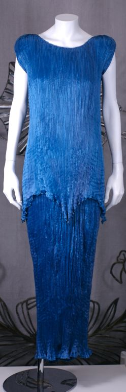 This dress is made of finely pleated  cobalt blue colored silk with silk cording along side seams ,shoulders , and tunic hem, and multicolored glass beads threaded through the cording .<br />