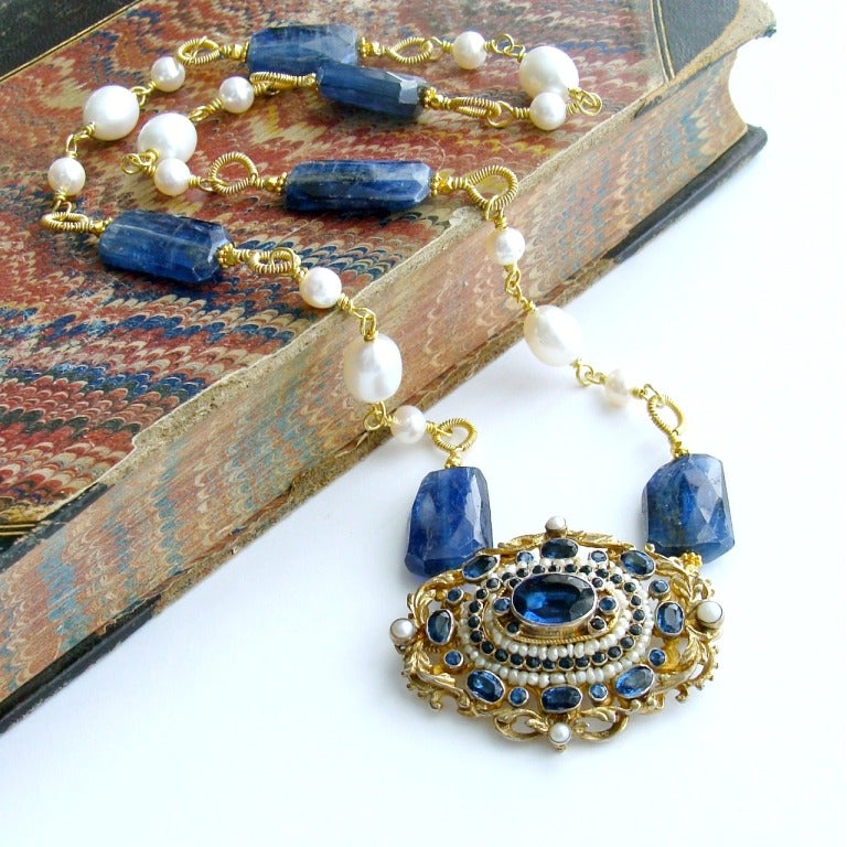 Eliza Necklace - A stunning antique Austro Hungarian sapphire blue paste and pearls brooch has become both the focal point as well as the clasp, for a necklace of hand-coiled kyanite nuggets and freshwater pearls.  This unique design allows the