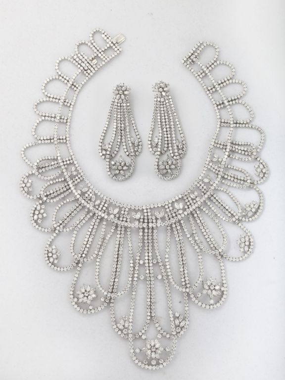 An extraordinary suite of platinum and white diamonds necklace and earrings signed HOB.The House of Baguettes