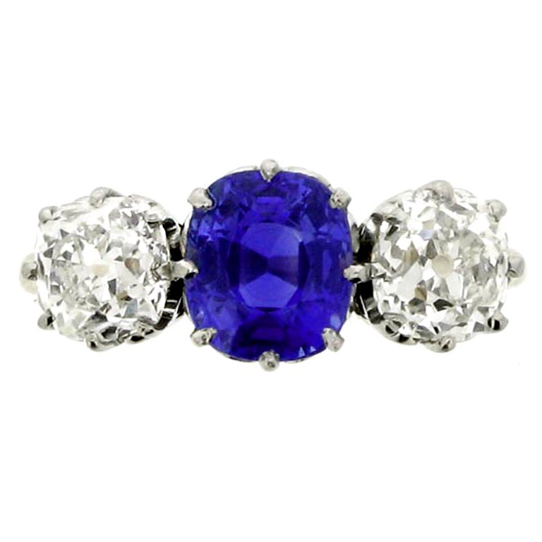 Natural Kashmir sapphire and diamond three stone ring, circa 1910.
