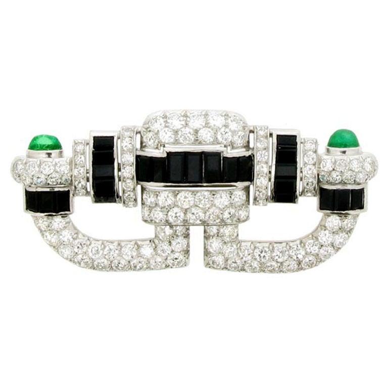 Art Deco onyx, diamond and emerald cabochon brooch, circa 1925.