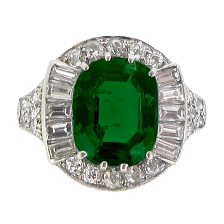 Natural Emerald and diamond cluster ring, circa 1925.