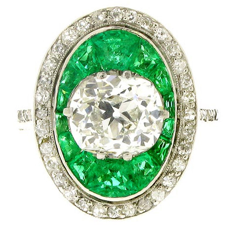 Antique old mine cut diamond and emerald ring For Sale at 1stdibs