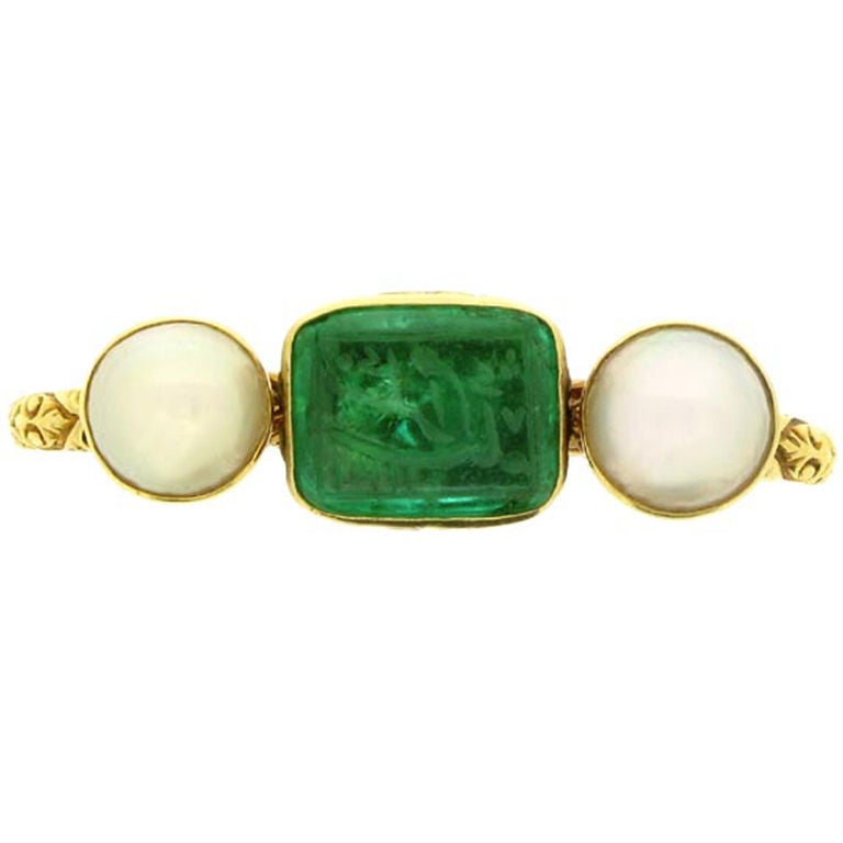 carved emerald and pearl finger ring at 1stdibs