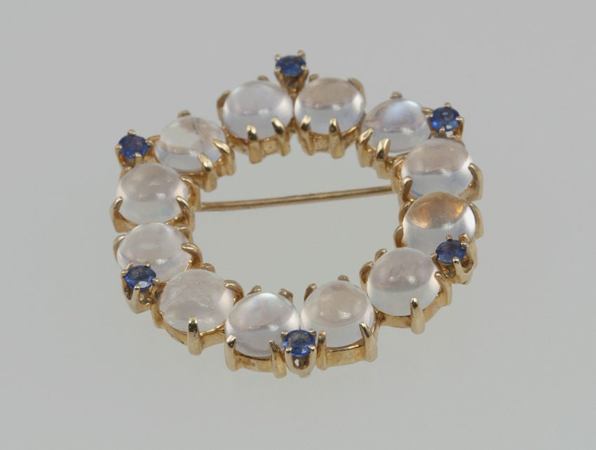 14k gold round brooch of moonstones and six little sapphires just for some color, I always love that combination.
