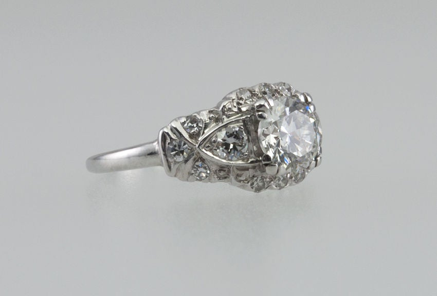 Platinum ring with a ton of sparkle! The center round brilliant diamond is 1.17 ct. H-SI1 with an EGl certificate. Then surrounding the center stone are a combination of full and single cut diamonds equaling approximately another carat. All in