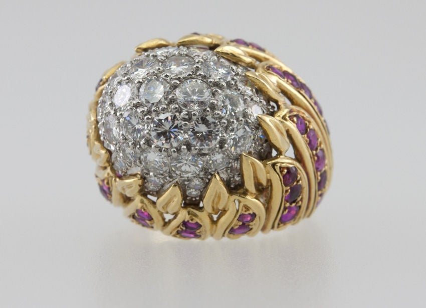 Diamond and ruby large cocktail ring in 18 karat yellow gold with a flame design all filled with rubies, leading to a center of pave diamonds, which total 2 carats of total diamond weight. Very dramatic and sexy! Circa 1970s.  Currently a US size