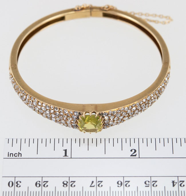 18k Victorian bangle paved with approximately 3 carats of rose cut diamonds, and a center soft lime green citrine. It si wider in the center and tapers toward the back.  This bangle has sparkle to spare!