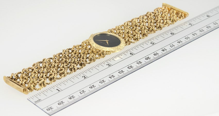 Bueche Girod chic lady's 18k yellow gold link bracelet watch with onyx dial and manual-wind movement.