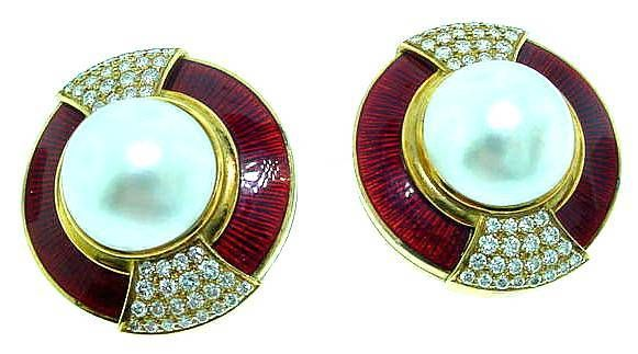 "This is a breathtaking pair of designer earrings by Leo de Vroomen, featuring red enamel, white  mabe  pearls, and diamonds. 1.25"" diameter."
