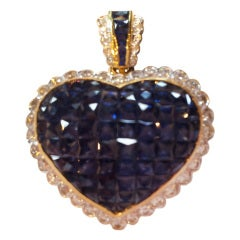 Heart  shaped invisibly set sapphire pin/pendant, c. 1980.