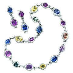Important natural colored sapphire & diamond set