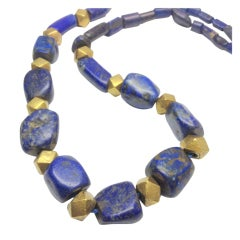 Long lapis and gold necklace by Julius Cohen