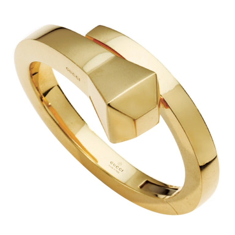 Gold bangle bracelet by Gucci 1