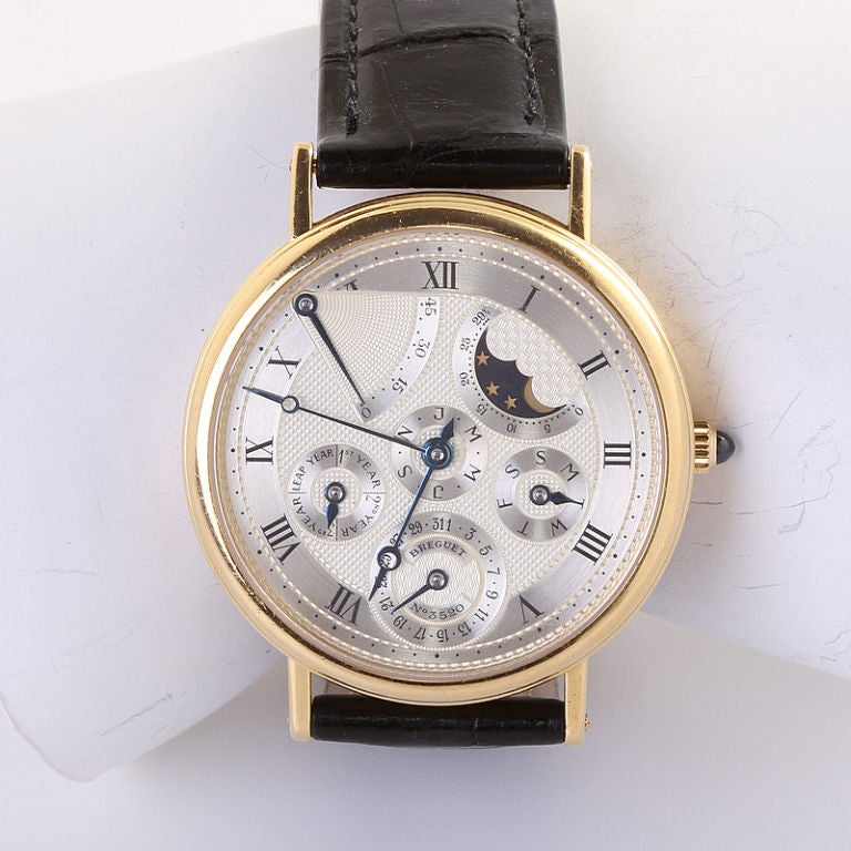 Breguet 18k yellow gold perpetual calendar wristwatch with moon phase and power reserve from the Classique Complications Collection with Alligator Strap. In great condition this watch has a transparent case back so the movement is visible. Original