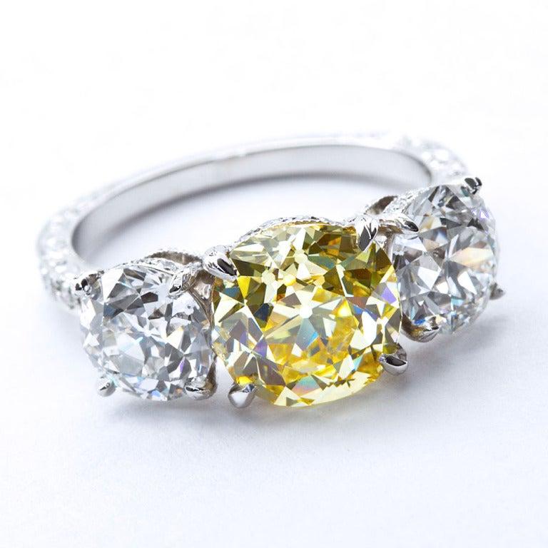 Edwardian 2.72 Carat Old Mine Fancy Yellow Three-Stone Diamond Ring GIA Certified For Sale