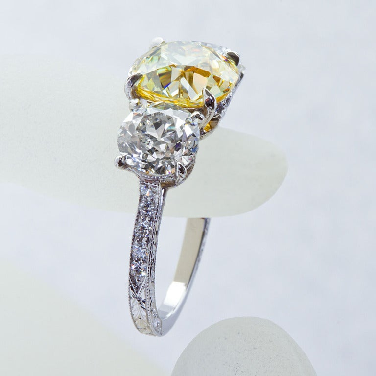 Old European Cut 2.72 Carat Old Mine Fancy Yellow Three-Stone Diamond Ring GIA Certified For Sale