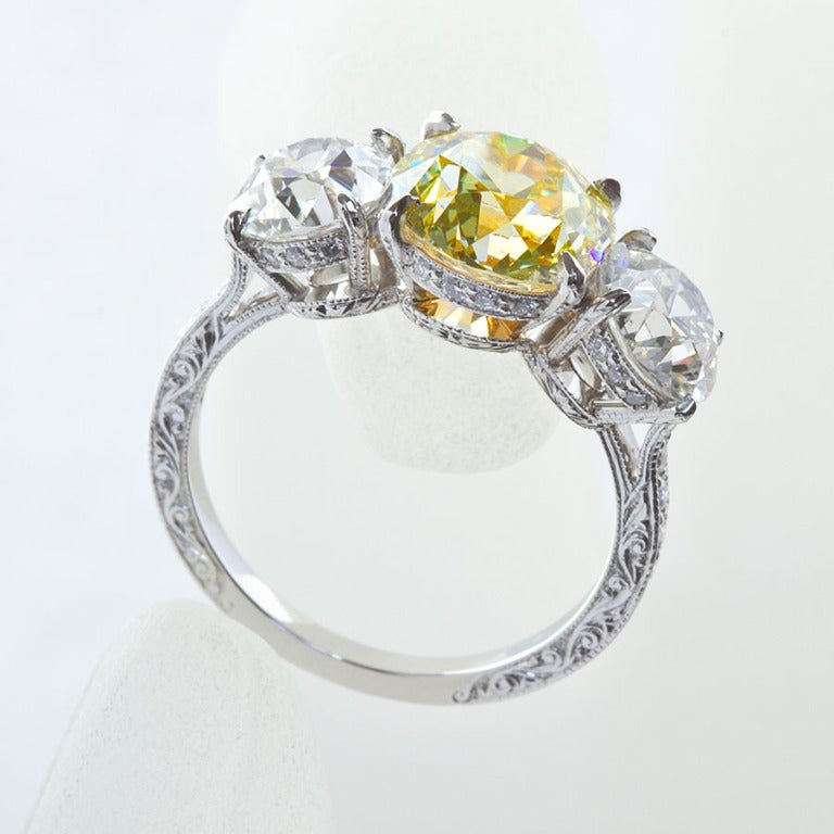 2.72 Carat Old Mine Fancy Yellow Three-Stone Diamond Ring GIA Certified In Excellent Condition For Sale In New York, NY