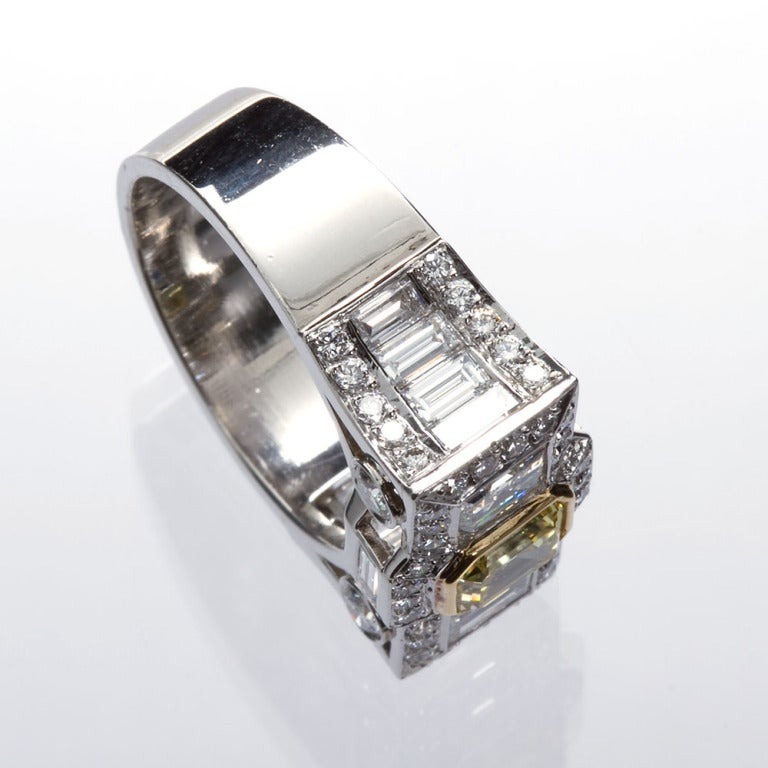 0.87 Carat Fancy Intense Yellow Emerald-Cut Diamond Gold Platinum Ring In Excellent Condition For Sale In New York, NY