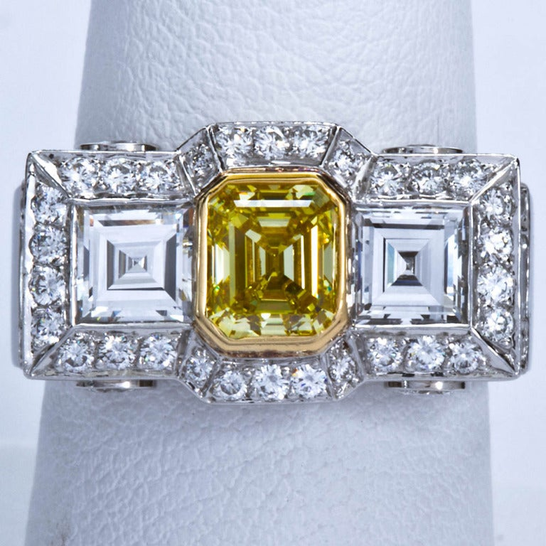 Women's 0.87 Carat Fancy Intense Yellow Emerald-Cut Diamond Gold Platinum Ring For Sale