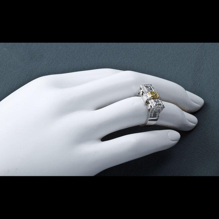 0.87 Carat Fancy Intense Yellow Emerald-Cut Diamond Gold Platinum Ring For Sale 1