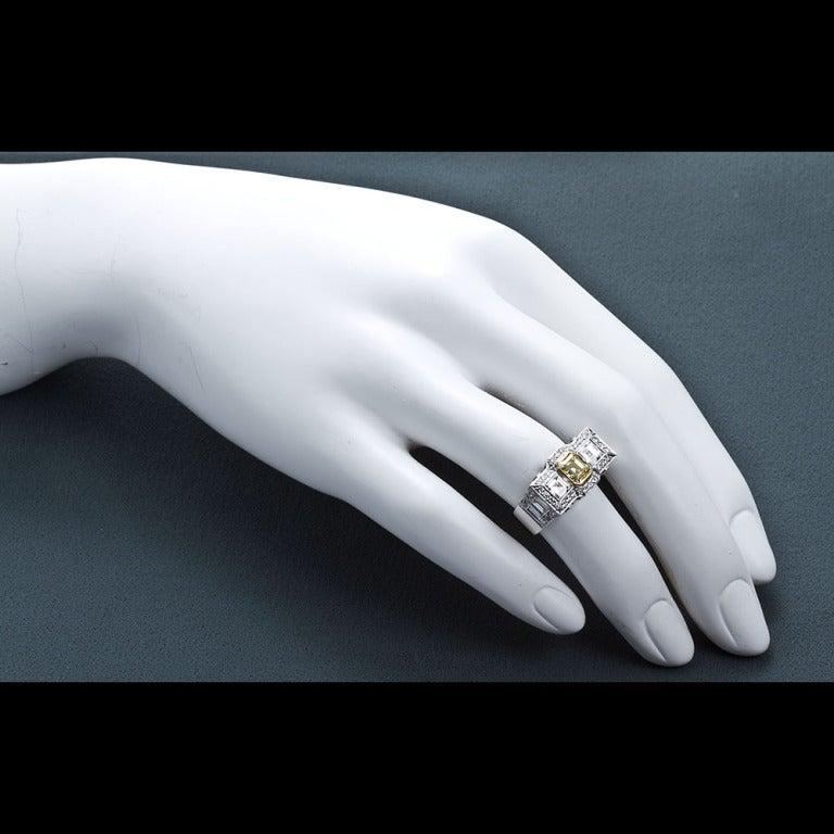 0.87 Carat Fancy Intense Yellow Emerald-Cut Diamond Gold Platinum Ring For Sale 2