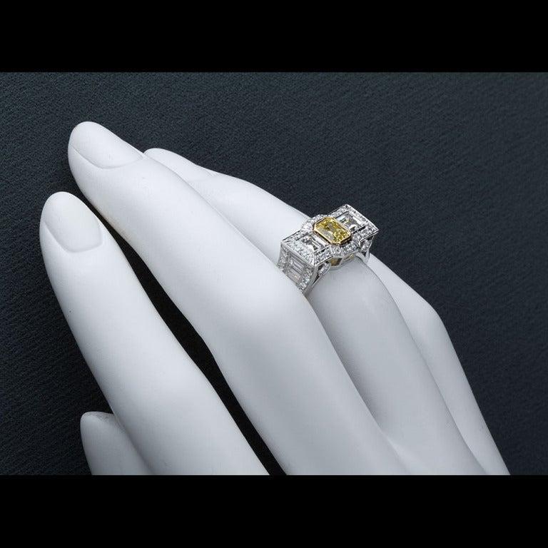 0.87 Carat Fancy Intense Yellow Emerald-Cut Diamond Gold Platinum Ring For Sale 3