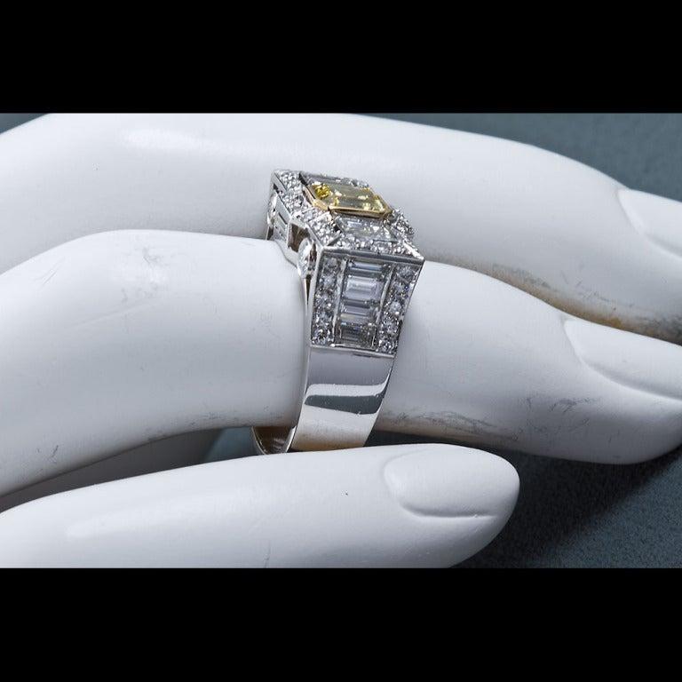0.87 Carat Fancy Intense Yellow Emerald-Cut Diamond Gold Platinum Ring For Sale 4