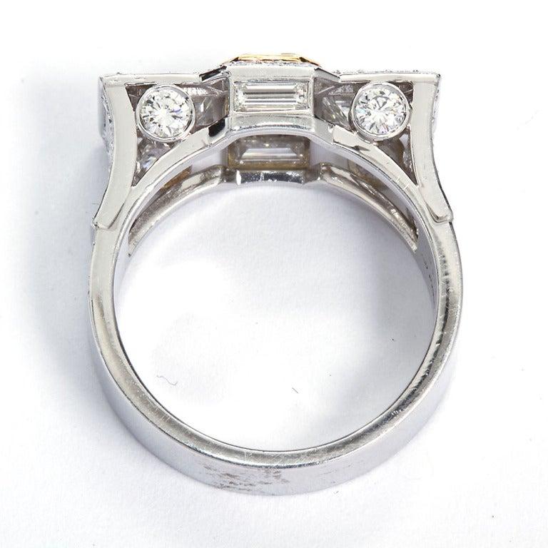 0.87 Carat Fancy Intense Yellow Emerald-Cut Diamond Gold Platinum Ring For Sale 5