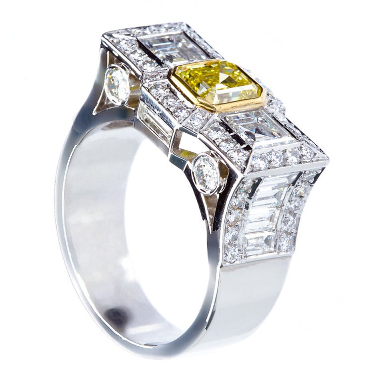 0.87 Carat Fancy Intense Yellow Emerald-Cut Diamond Gold Platinum Ring