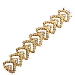 Gold Textured Wide Chevron Style Bracelet