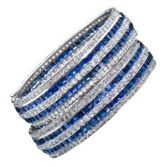 Pair of Identical Art Deco Sapphire Diamond Platinum Bangle Bracelets