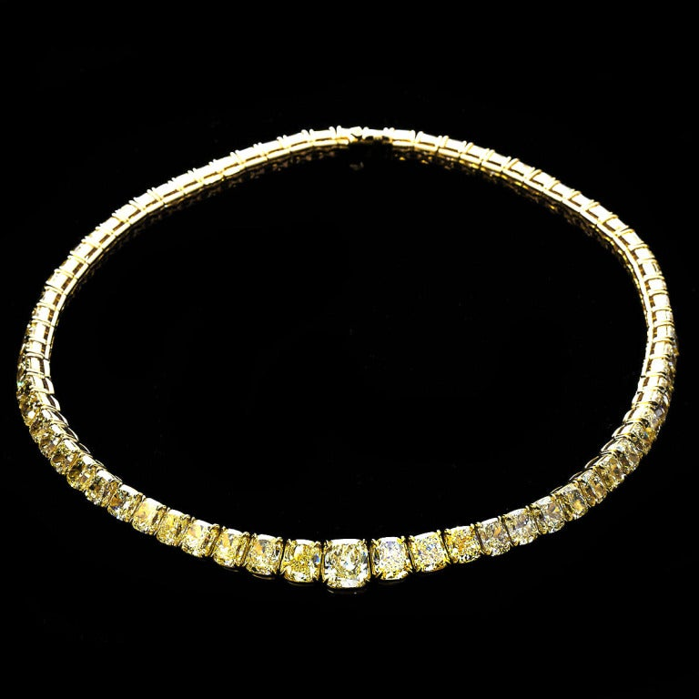 A graduated cushion cut yellow diamond necklace set in 18k yellow gold with a center stone of 4.24 carats. Over 100 carats total. Necklace measures 17 inches.   No. 4730
