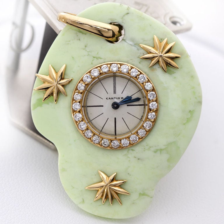 Rare fanciful Cartier jade watch pendant with 18k gold star bursts. 24 diamonds grace the perimeter of the bezel. The pendant measures 43mm (1-7/10 inches)  tall and 34mm (1-1/3 inches) wide. It weighs 20.5 gram. EJ stamping indicates maker was