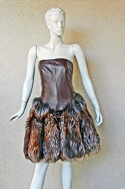 Alexander McQueen's 2007 leather and fur combination designed to give fashionistas the ultimate fashion thrill!   Strapless bronzish brown ultra soft fine quality lambskin leather molded into a boned body hugging corset with skirt extending into