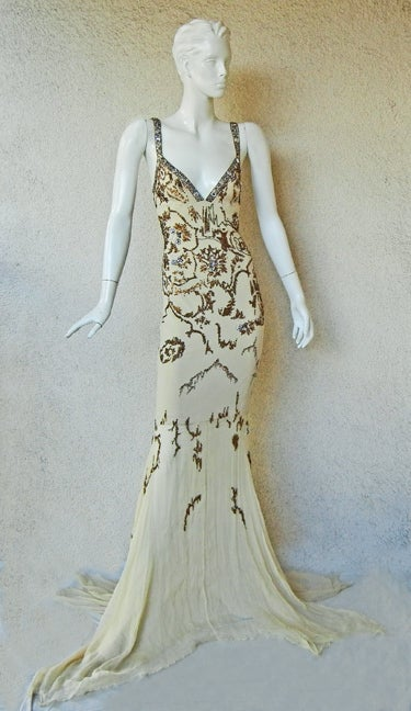 Roberto Cavalli 30's inspired Old Hollywood vintage gown.  Hand beaded and bejeweled bias cut drape with oversize handkerchief hemline.   Fashioned of a soft champagne silk chiffon.   Complimentary beadwork in shades of gold, silver, bronze with