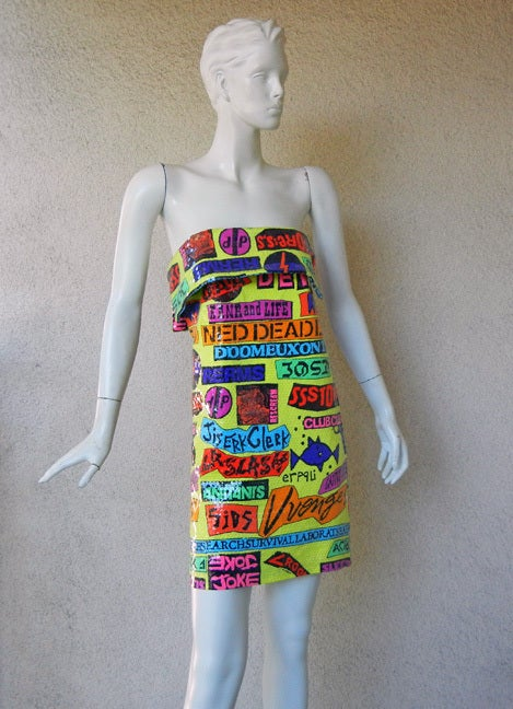 Stephen Sprouse (1953-2004) recognized as both an artist and fashion designer, took his famous rock sticker graphic inspiration from the club and punk rock scene of the 1970's and 80's.   He designed this circa 1988 collection as pictured on page