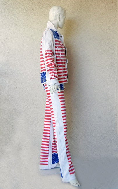 D&G pre-washed white denim American stars and stripes jean jacket and matching jeans. Rough cut at hemline.  This iconic 2002 ensemble can be worn by either male or female.  Jacket size: 38; bust: to 40