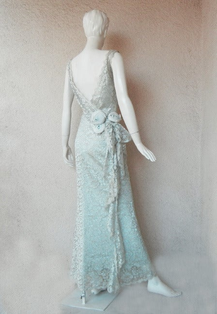 Circa 1998 Christian Dior by John Galliano. Exquisitely elegant bashful blue chantilly lace creation influenced by the 30's Gatsby era.  Cut and tailored with Galliano's meticulously designed earlier work the dress boasts the flair and  inspiration