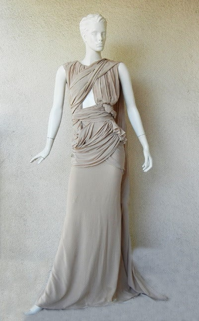 From the House of Vionnet an exquisite grecian style gown fashioned in sand silk.  Draped, ruched, and hand knotted   techinques utilized in designing this dramatic piece.  Very reminiscent of the early days of Madeline Vionnet's creations.    Bias